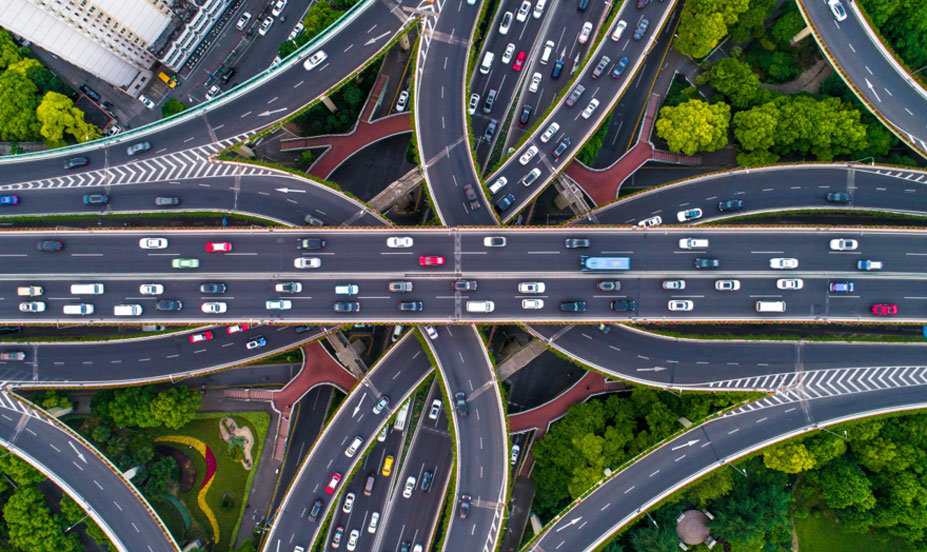 Overhead shot of a busy highway with multiple lanes, entries, and exits. With Magento 1 being discontinued, it makes sense to migrate over to Magento 2, but doing so isn't as easy as one would imagine.
